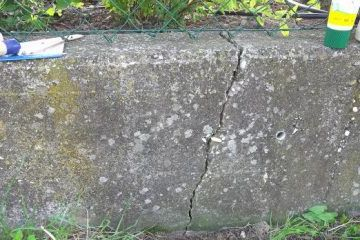 There is a gap in the concrete wall